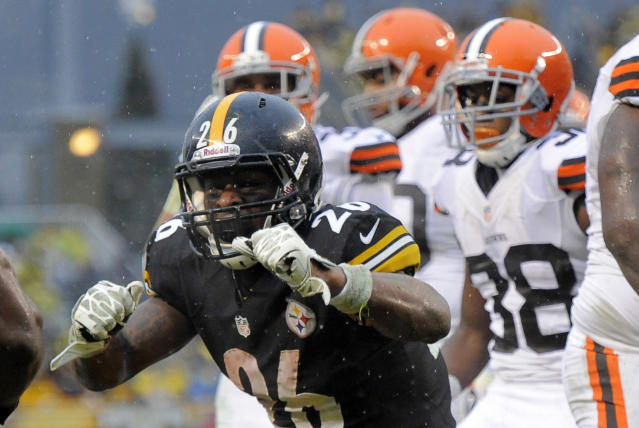 Pittsburgh Steelers running back Le'Veon Bell (26) celebrates after scoring a touchdown against the Cleveland Browns in the second quarter of an NFL football game on Sunday, Dec. 29, 2013, in Pittsburgh. (AP Photo/Don Wright)
