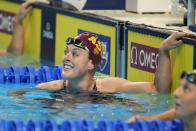 Allison Schmitt reacts after winning her heat in the Women's 200 Freestyle during wave 2 of the U.S. Olympic Swim Trials on Tuesday, June 15, 2021, in Omaha, Neb. (AP Photo/Charlie Neibergall)
