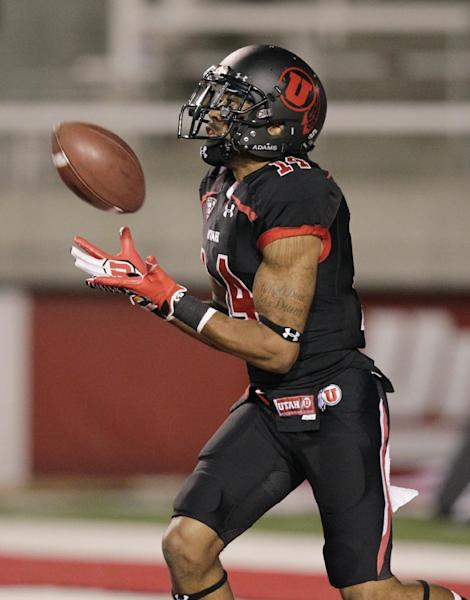 Utah wide receiver Reggie Dunn (14) catches the football during a kick off return for a touch down against California in the first quarter during an NCAA college football game Saturday, Oct. 27, 2012, in Salt Lake City. (AP Photo/Rick Bowmer)