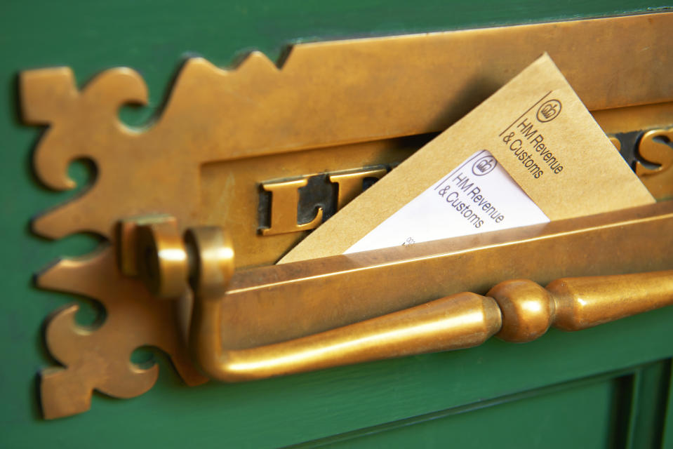 Photograph shows a front door letter box with HMRC envelope, Her Majestys Revenue and Customs (HMRC) reminding of the date that self-assessment tax returns need to be completed by self-employed companies and individuals. Photographed by Peter Dazeley, London, November 2020
