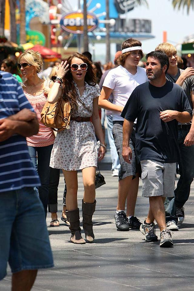 "To put it mildly, Miley's shirt dress is mediocre, her oversized sunglasses are gross, and her boots aren't made for walkin'. Darren Banks/<a href=""http://www.splashnewsonline.com"" target=""new"">Splash News</a> - July 8, 2008"