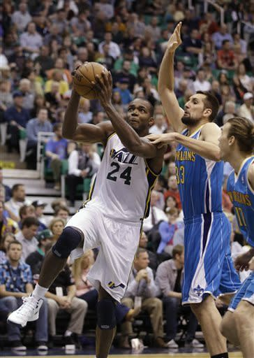 Utah Jazz's Paul Millsap (24) goes to the basket as New Orleans Hornets' Ryan Anderson (33) defends in the second quarter during an NBA basketball game Friday, April 5, 2013, in Salt Lake City. (AP Photo/Rick Bowmer)