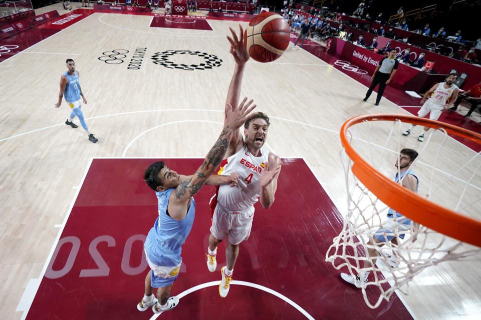 Spain's Pau Gasol (4) shoots over Argentina's Gabriel Deck (14) during a men's basketball preliminary round game at the 2020 Summer Olympics, Thursday, July 29, 2021, in Saitama, Japan. (AP Photo/Eric Gay)
