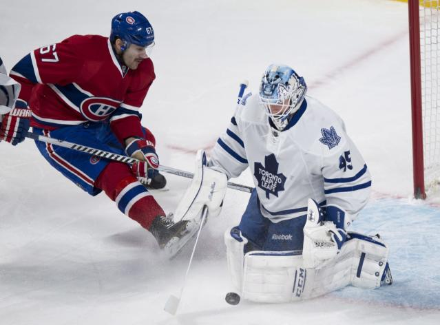 Montreal Canadiens' Max Pacioretty is stopped by Toronto Maple Leafs goalie Jonathan Bernier during the second period of an NHL hockey game Saturday, Nov. 30, 2013 in Montreal. (AP Photo/The Canadian Press, Paul Chiasson)