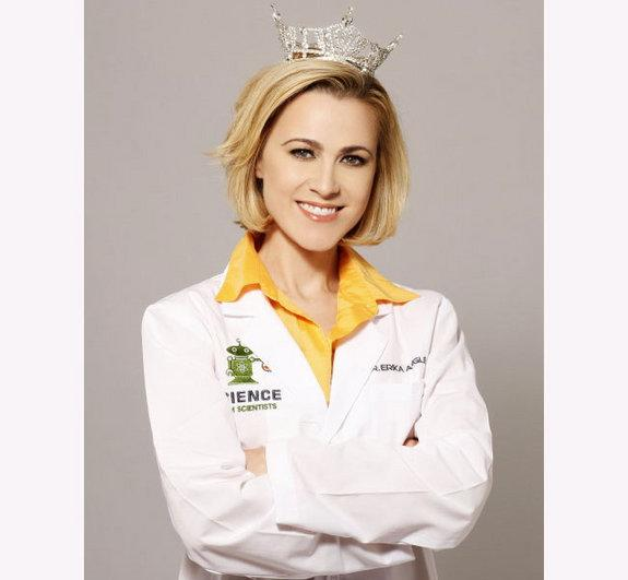 Erika Ebbel Angle wears both a pageant tiara and lab coat in her Dr. Erika TV show..