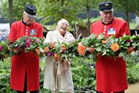 <p>Dame Judi Dench smiles wide as she stands with Chelsea pensioners to open the Queen's Garden display during the 2021<br> RHS Chelsea Flower Show in London on Sept. 20.</p>