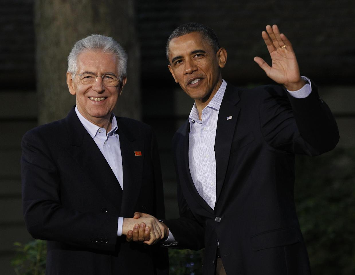 President Barack Obama, right, shakes hands with Italy's Prime Minister Mario Monti on arrival for the G8 Summit Friday, May 18, 2012 at Camp David, Md. (AP Photo/Charles Dharapak)