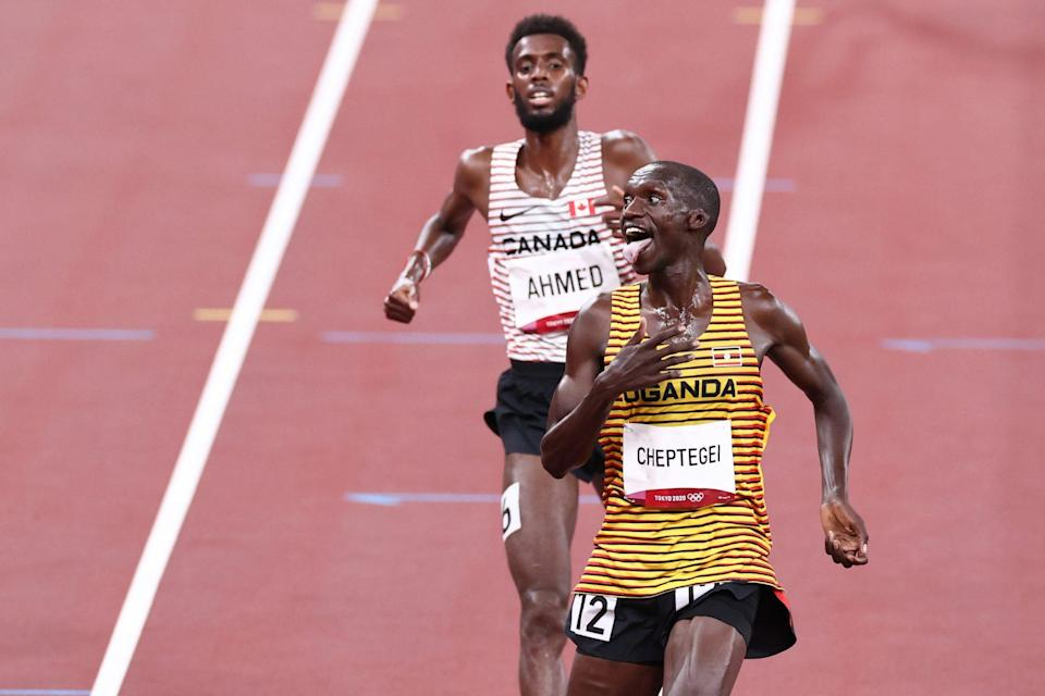 <p>Team Uganda's Joshua Cheptegei reacts to winning the gold medal during the Men's 5000m Final. </p>