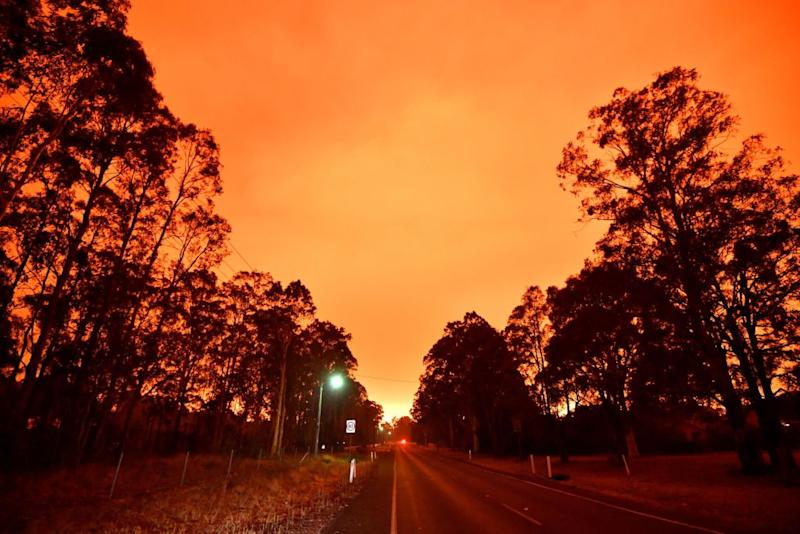 The orange sky pictured in Nowra, 60km north of Yatte Yattah, on Tuesday. Source: Getty