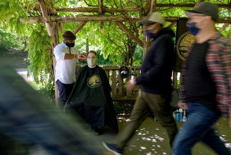 Barber Herman James, seen here on May 6, 2021, takes bookings and walk-ins at his spot in Central Park