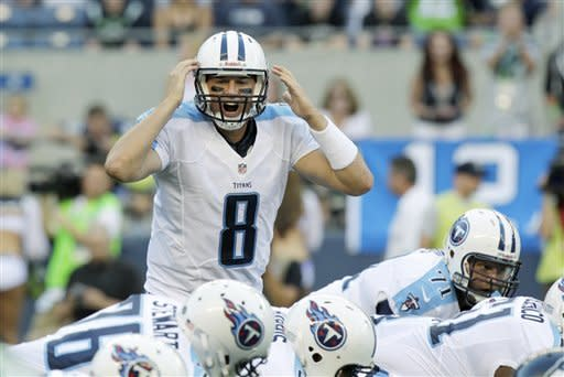 Tennessee Titans quarterback Matt Hasselbeck yells to his team in the first half of an NFL football preseason game against the Seattle Seahawks, Saturday, Aug. 11, 2012, in Seattle. (AP Photo/Rick Bowmer)