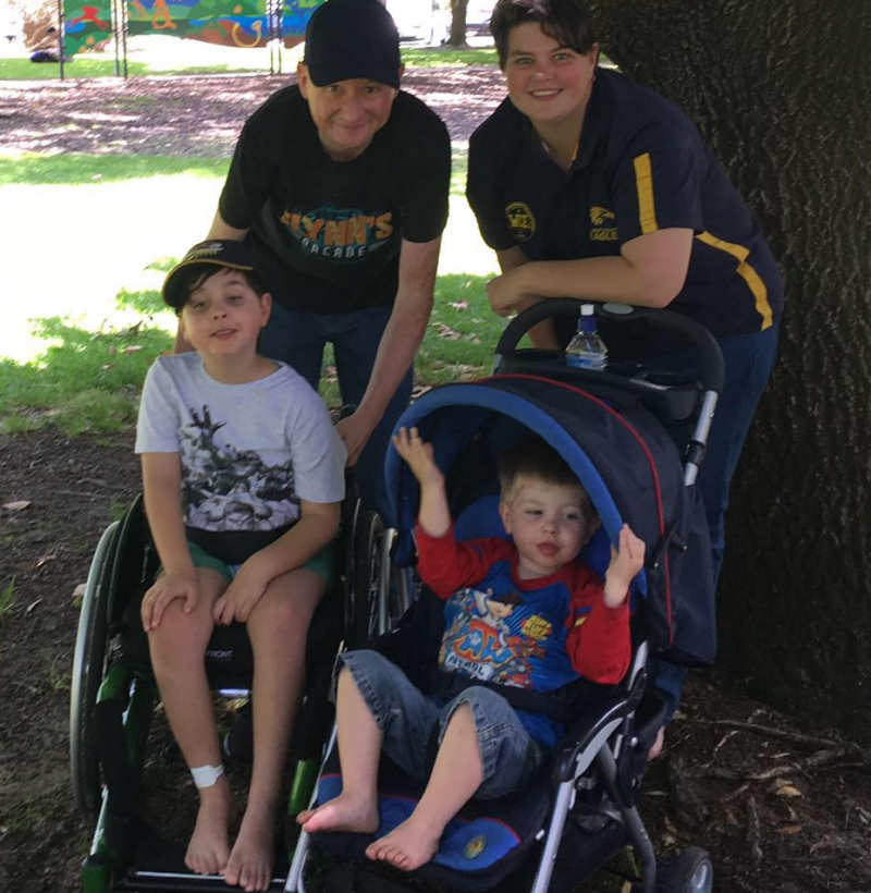 Photo of Perth parents Luke and Amy with their children Logan (left) and Flynn (right).