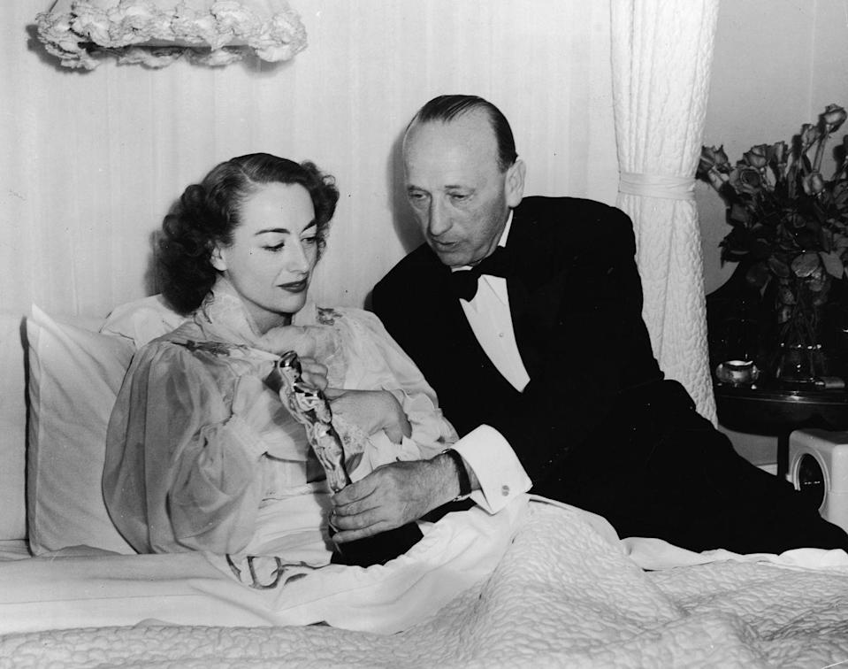 <p>Joan fell ill before the Academy Awards, in which she won Best Actress for <em>Mildred Pierce. </em>The actress is famously known for calling the press to her bedroom to accept her award. </p>