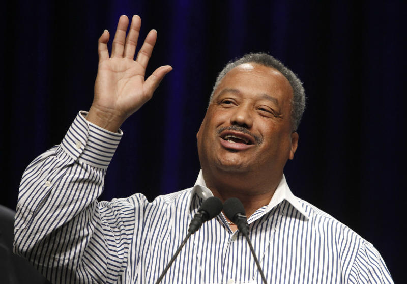 "Pastor Fred Luter acknowledges the crowd at the Southern Baptist Convention prior to to being elected as the first African-American vice president of the organization, Tuesday, June 14, 2011, in Phoenix.  The move to elect Luter comes at the same time the SBC is making a push for greater participation among what it sometimes calls its ""non-Anglo"" members in the life of the convention, particularly in leadership roles.  Luter's church is one of an estimated 3,400 black churches in the nation's largest Protestant denomination, a small minority of more than 45,700 total SBC-affiliated churches with about 16 million members total. (AP Photo/Ross D. Franklin)"