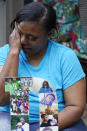Tammie Townsend tears up as she speaks about her eldest son, Willie Jones Jr., 21, and the incident where he was found hanging from a tree in his girlfriend's Scott County yard three years ago, Tuesday, April 27, 2021, while at his grandmother's home in Forest, Miss. A Hinds County judge recently awarded the family $11 million in a civil suit related to his death. (AP Photo/Rogelio V. Solis)