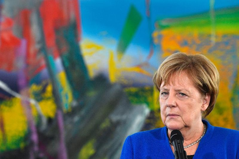 """German Chancellor Angela Merkel's uneasy left-right """"grand coalition"""" could face """"a fight for its survival"""", the Sueddeutsche daily said (AFP Photo/John MACDOUGALL)"""
