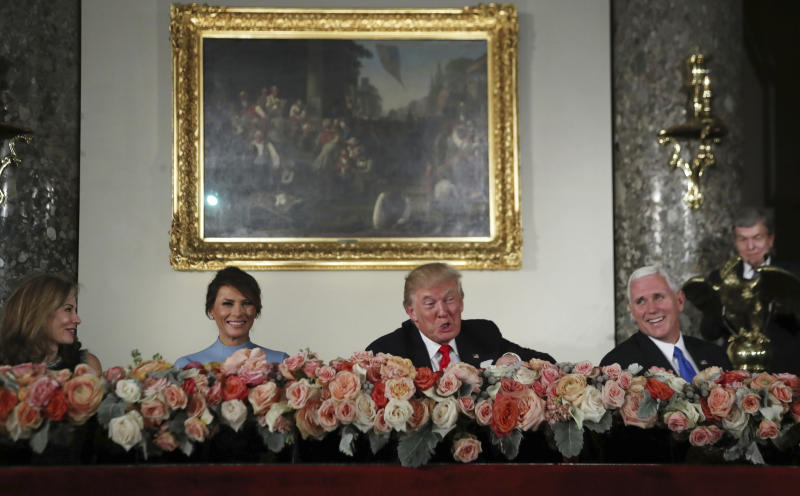 FILE - In this Jan. 20, 2017 file photo, President Donald Trump with his wife Melania Trump, second from left, Vice President Mike Pence, right, and Sen. Roy Blunt, R- Mo., right, and his wife Abigail Blunt, left, laugh during the inaugural luncheon in Statuary Hall on Capitol Hill in Washington. Anna Cristina Niceta Lloyd auditioned for the job of White House social secretary and may not have known it. The veteran event planner's creativity and handicraft were prominently on display at President Donald Trump's inaugural luncheon at the Capitol, the fifth one she has worked on.  (AP Photo/Manuel Balce Ceneta, File)