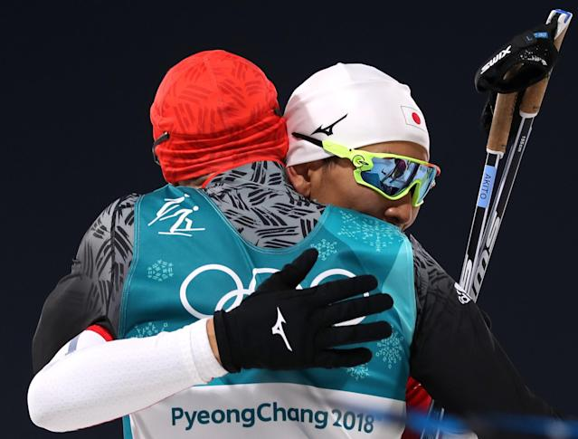 Nordic Combined Events - Pyeongchang 2018 Winter Olympics – Men's Individual 10km Final – Alpensia Cross-Country Skiing Centre - Pyeongchang, South Korea – February 14, 2018. Eric Frenzel of Germany and Akito Watabe of Japan react. REUTERS/Carlos Barria