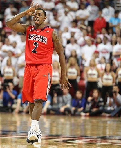 Arizona's Mark Lyons celebrates after hitting a 3-point basket against Texas Tech during an NCAA college basketball game in Lubbock, Texas, Saturday, Dec. 1, 2012. (AP Photo/Lubbock Avalanche-Journal, Zach Long)