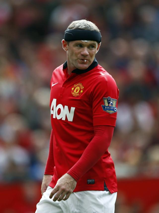 """Manchester United's Wayne Rooney reacts during their English Premier League soccer match against Crystal Palace at Old Trafford in Manchester, northern England September 14, 2013. REUTERS/Darren Staples (BRITAIN - Tags: SPORT SOCCER PROFILE) FOR EDITORIAL USE ONLY. NOT FOR SALE FOR MARKETING OR ADVERTISING CAMPAIGNS. NO USE WITH UNAUTHORIZED AUDIO, VIDEO, DATA, FIXTURE LISTS, CLUB/LEAGUE LOGOS OR """"LIVE"""" SERVICES. ONLINE IN-MATCH USE LIMITED TO 45 IMAGES, NO VIDEO EMULATION. NO USE IN BETTING, GAMES OR SINGLE CLUB/LEAGUE/PLAYER PUBLICATIONS"""