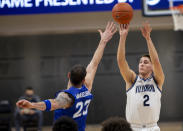 Villanova guard Collin Gillespie (2) takes a shot over Seton Hall forward Sandro Mamukelashvili (23) during the first half of an NCAA college basketball game, Tuesday, Jan. 19, 2021, in Villanova, Pa. (AP Photo/Laurence Kesterson)