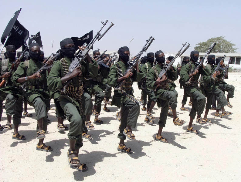 """FILE - In this Thursday, Feb. 17, 2011 file photo, hundreds of newly trained al-Shabab fighters perform military exercises in the Lafofe area some 18 km south of Mogadishu, in Somalia. U.N. experts said in a report circulated Tuesday, Nov. 12, 2019 that al-Shabab extremists in Somalia remain """"a potent threat"""" to regional peace and are manufacturing home-made explosives, expanding their revenue sources and infiltrating government institutions. (AP Photo/Farah Abdi Warsameh, File)"""