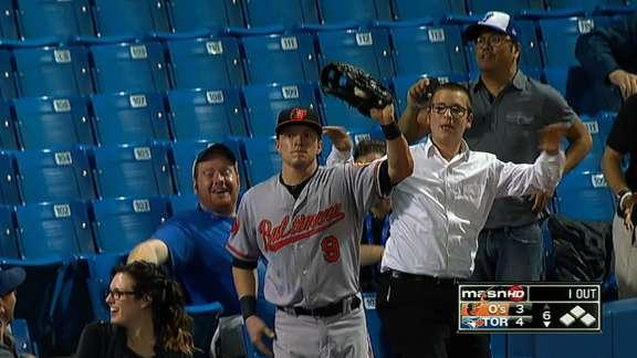Nate McLouth falls into crowd to make a great catch, gets a beer tossed at him afterward