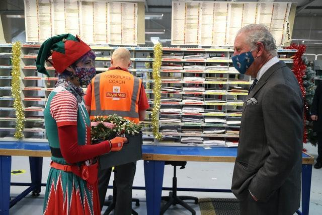 The Prince of Wales meets Royal Mail employee Catherine Griffiths. Geoff Caddick/PA Wire