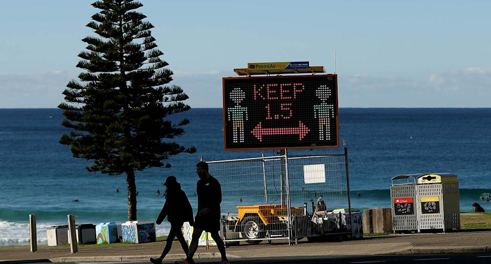 A photo taken a Bondi Beach telling people to stay 1.5 metres apart due to current Covid restrictions.