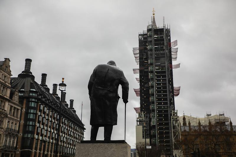 Statue of Winston Churchill at Parliament Square and a view on Big Ben being repaired in London, United Kingdom on 10 December, 2019. UK General Election will be held on 12 December, 2019. (Photo by Beata Zawrzel/NurPhoto via Getty Images)