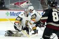 Arizona Coyotes right wing Conor Garland (83) scores a goal against Vegas Golden Knights goaltender Robin Lehner (90) as Golden Knights defenseman Alec Martinez (23) looks for the puck during the third period of an NHL hockey game Friday, Jan. 22, 2021, in Glendale, Ariz. (AP Photo/Ross D. Franklin)