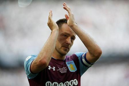 Soccer Football - Championship Play-Off Final - Fulham vs Aston Villa - Wembley Stadium, London, Britain - May 26, 2018 Aston Villa's John Terry looks dejected as he applauds the fans at the end of the match. Action Images via Reuters/Carl Recine