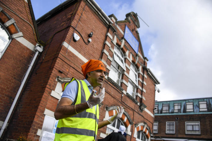 Professor Gurch Randhawa speaks to the media outside the Guru Nanak Gurdwara Sikh temple, on the day the first Vaisakhi Vaccine Clinic is launched, in Luton, England, Sunday, March 21, 2021. (AP Photo/Alberto Pezzali)