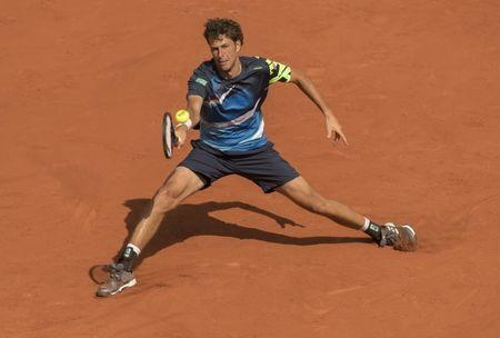 FILE PHOTO: May 31, 2017; Paris, France; Robin Haase (NED) in action during his match against Rafael Nadal (ESP) (not pictured) on day four of the 2017 French Open tennis tournament at Stade Roland Garros. Mandatory Credit: Susan Mullane-USA TODAY Sports