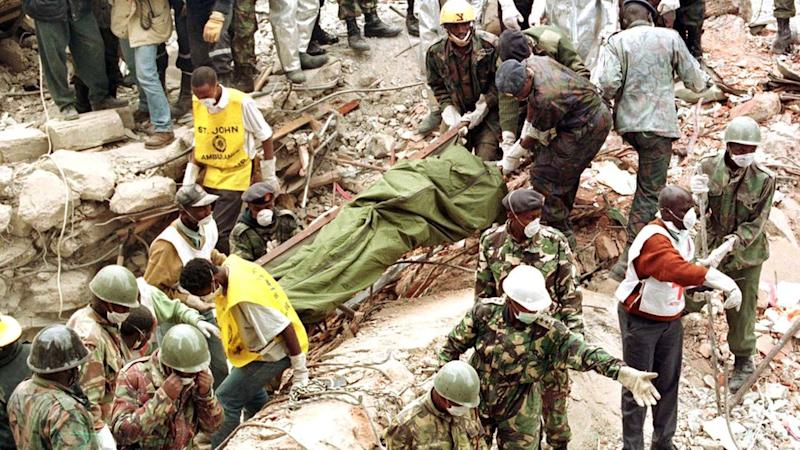 Stretcher being pulled out of the rubble