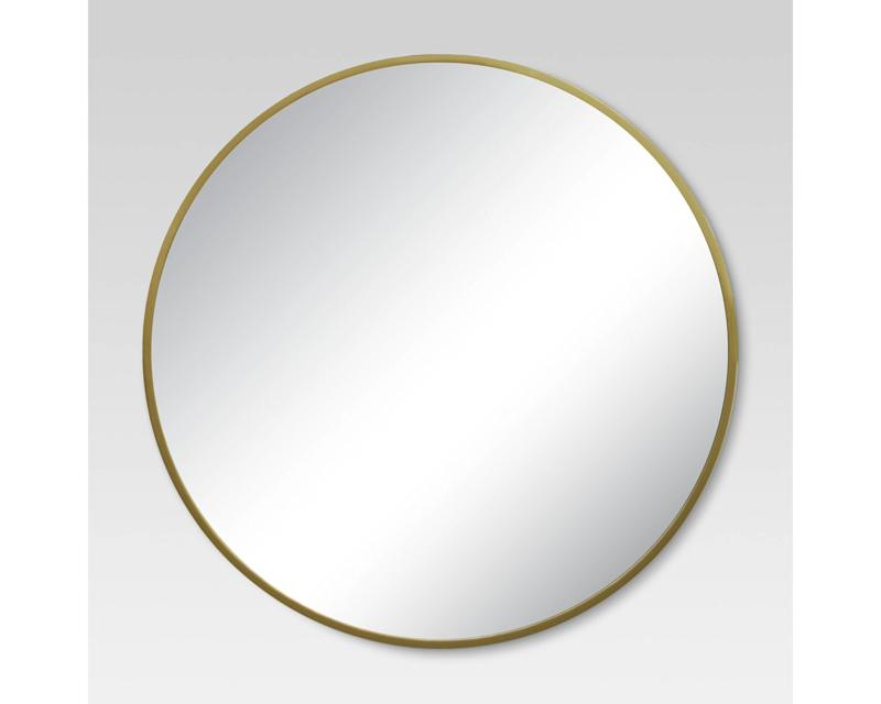 """Get it at <a href=""""https://www.target.com/p/round-decorative-wall-mirror-brass-project-62-153/-/A-50301089#lnk=newtab"""" target=""""_blank"""">Target, $50</a>."""