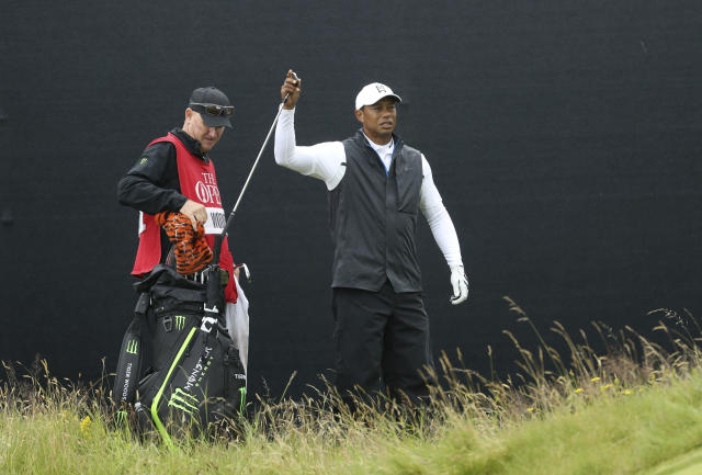 Tiger Woods of the United States get his club out of his bag on the 17th green during the second round of the British Open Golf Championships at Royal Portrush in Northern Ireland, Friday, July 19, 2019.(AP Photo/Peter Morrison)