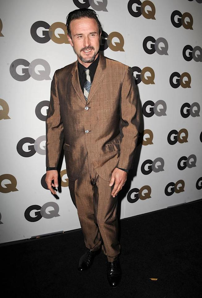 "Footloose and fancy free David Arquette rocked a signature eccentric brown suit paired with a striped tie and black shirt. Steve Granitz/<a href=""http://www.wireimage.com"" target=""new"">WireImage.com</a> - November 17, 2010"