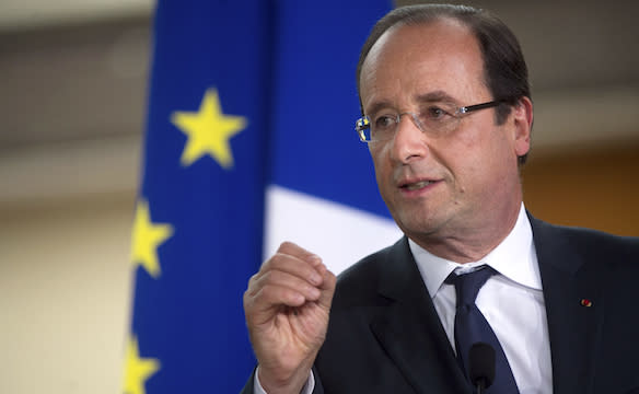 French President Hollande delivers a speech during a visit to an elementary school in Dieudonne