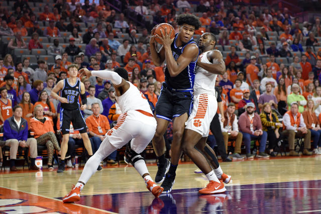 Duke's Vernon Carey Jr., center, works while defended by Clemson's Clyde Trapp, left, and Aamir Simms during the first half of an NCAA college basketball game Tuesday, Jan. 14, 2020, in Clemson, S.C. (AP Photo/Richard Shiro)