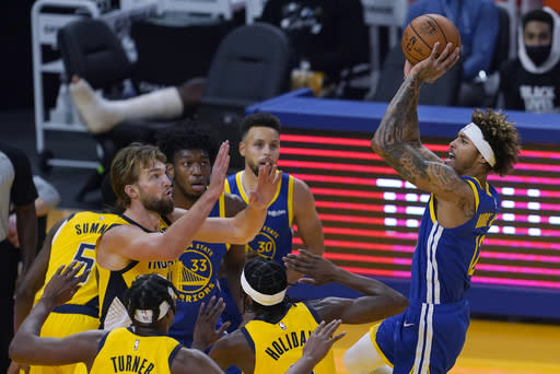 Golden State Warriors guard Kelly Oubre Jr. shoots against the Indiana Pacers during the first half of an NBA basketball game in San Francisco, Tuesday, Jan. 12, 2021. (AP Photo/Jeff Chiu)