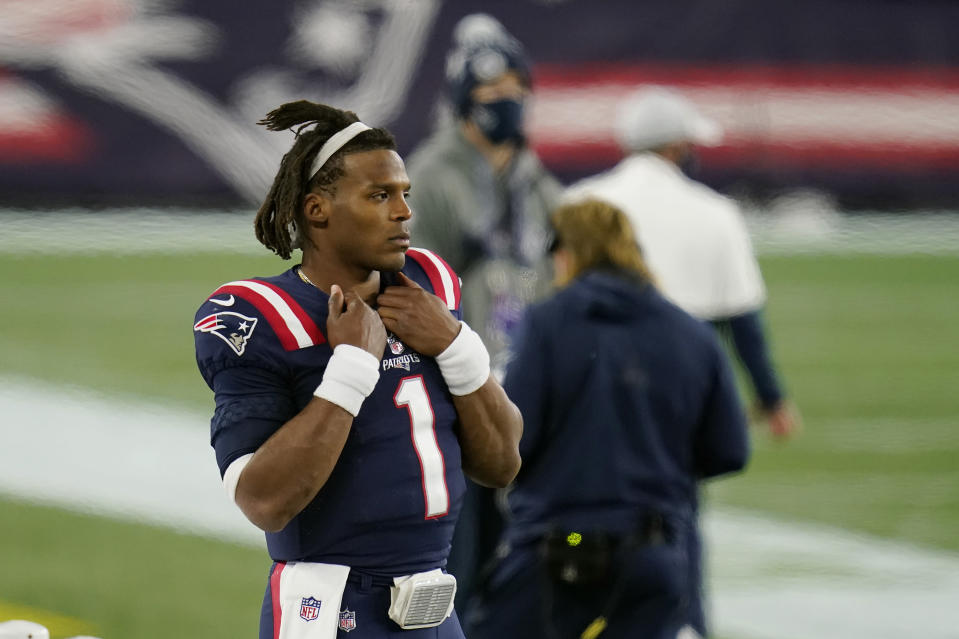 New England Patriots quarterback Cam Newton watches from the sideline after being replaced by Jarrett Stidham in the second half of an NFL football game against the San Francisco 49ers, Sunday, Oct. 25, 2020, in Foxborough, Mass. (AP Photo/Charles Krupa)