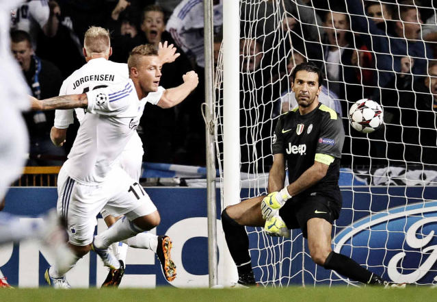 FC Copenhagen's Nicolai Jorgensen, in the background, celebrates scoring the opening goal with teammate Ragnar Sigurdsson of Iceland, foreground, as Juventus goalkeeper Gianluigi Buffon, right, looks on during their Champions League Group B soccer match at the Parken Stadium, Copenhagen, Denmark, Tuesday Sep. 17, 2013. (AP Photo/Polfoto/Jens Dresling)