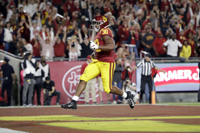 Southern California running back Markese Stepp (30) scores a rushing touchdown against Arizona during the first half of an NCAA college football game Saturday, Oct. 19, 2019, in Los Angeles. (AP Photo/Marcio Jose Sanchez)