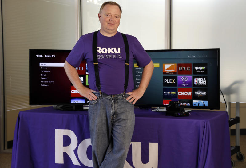 FILE - In this May 19, 2014, file photo, Roku CEO Anthony Wood poses for a portrait, in Saratoga, Calif. Shares of Roku, an early player in streaming-video gadgets, are soaring Thursday, Sept. 28, 2017, after an initial public offering raised $219 million. It is best known for its boxes and sticks that let users watch Netflix, Hulu and the growing universe of streaming-video options on their TVs. Roku has deep-pocketed competitors in Amazon, Google and Apple. (AP Photo/Marcio Jose Sanchez, File)