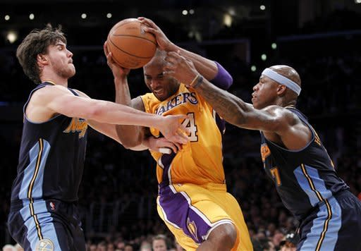 Los Angeles Lakers guard Kobe Bryant, middle, tries to drive though Denver Nuggets' Danilo Gallinari, left, and Al Harrington during the first half of Game 2 of an NBA basketball first-round playoff series, in Los Angeles on Tuesday, May 1, 2012. (AP Photo/Chris Carlson)