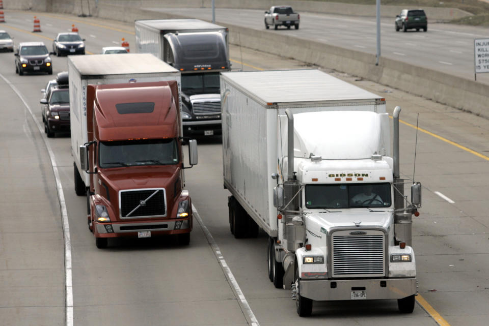 Two freight trucks are driven on the Fisher freeway in Detroit, Michigan (Photo: REUTERS/Rebecca Cook)