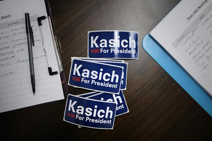 <p>Stickers are available for people attending a town hall meeting with Ohio Gov. John Kasich at American Legion Post 7, Feb. 1, 2016, in Rochester, N.H. This was Kasich's 87th town hall meeting in New Hampshire. <i>(Photo: Chip Somodevilla/Getty Images)</i></p>