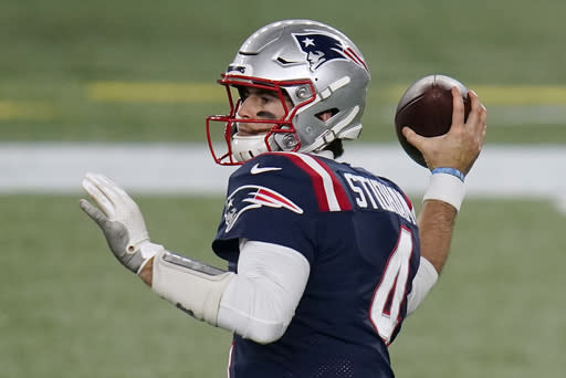 New England Patriots quarterback Jarrett Stidham drops back to pass in the second half of an NFL football game against the Buffalo Bills, Monday, Dec. 28, 2020, in Foxborough, Mass. (AP Photo/Charles Krupa)