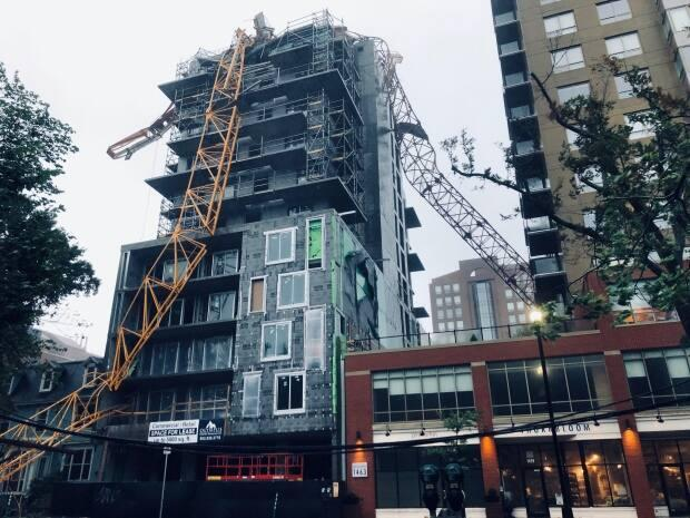 A crane on South Park Street in Halifax toppled onto a building under construction. (Craig Paisley/CBC - image credit)